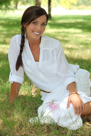 Attractive woman in a park photo