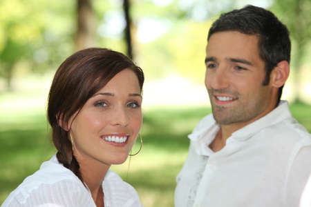 third age: Man contemplating brown-haired woman