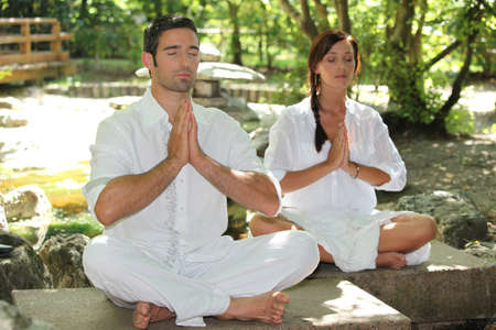 Couple doing relaxation exercises photo