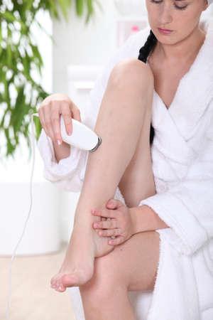 Woman shaving legs photo