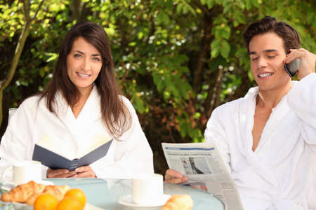 Couple eating breakfast outdoors photo