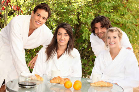 robes: Two couples sharing breakfast