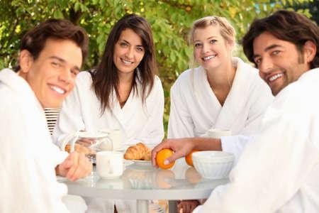 toweling: Friends having breakfast together