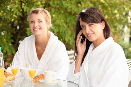 Young women having breakfast on the patio Stock Photo - 13882197