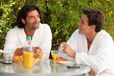 maintained: Two men eating breakfast in the garden