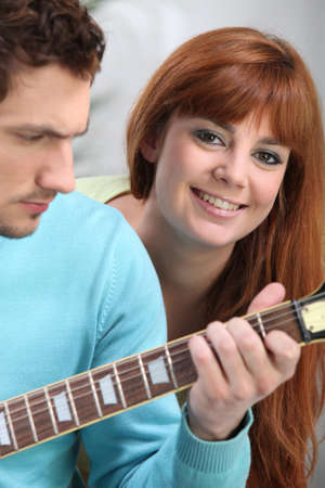 Youngster playing the guitar Stock Photo - 13882571