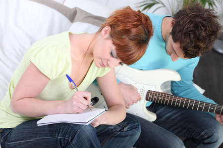 writing activity: youth writing song Stock Photo