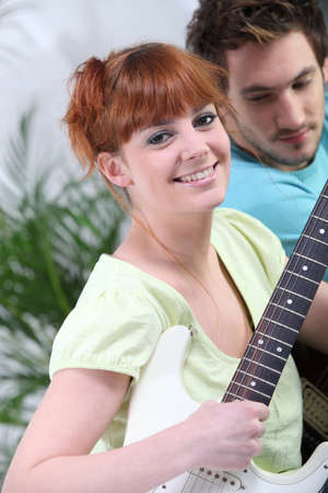 accomplices: Couple playing the guitar together Stock Photo