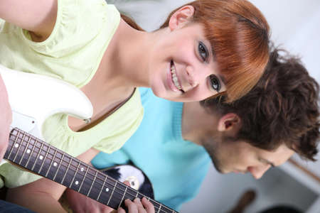 Horizontal image of girl with guitar Stock Photo - 13882491