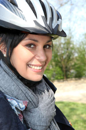 blue helmet: Young woman in a cyclist helmet Stock Photo