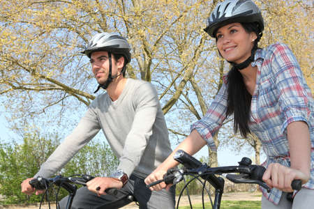 Couple cycling in autumn Stock Photo - 13882637