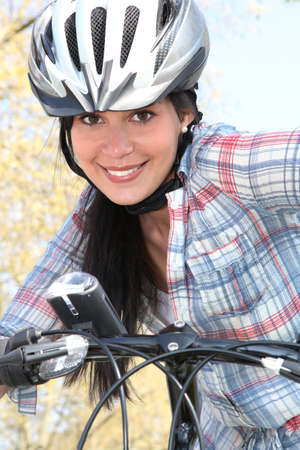 sensations: girl on bike with safety helmet