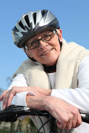 senior woman on a bike Stock Photo - 13882319