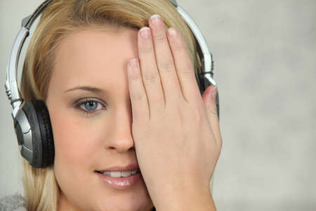 Young woman listening to music with headphones photo