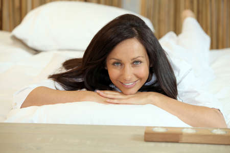 mature woman relaxing at home photo