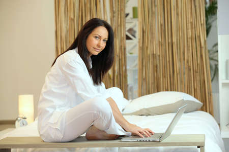 brunette working on laptop in Zen atmosphere Stock Photo - 13881935