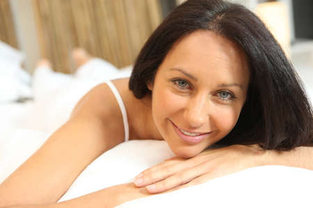 Brunette woman in bed photo