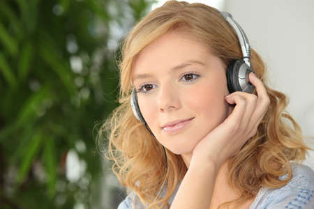 Young girl listening to music photo