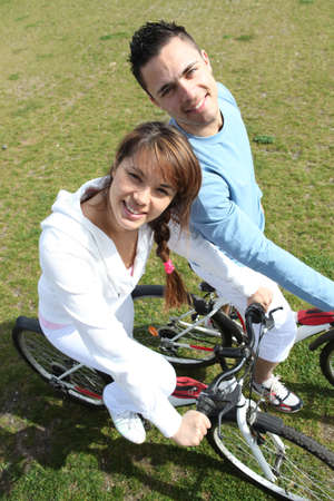 tracksuit: Couple relaxing on a bicycle