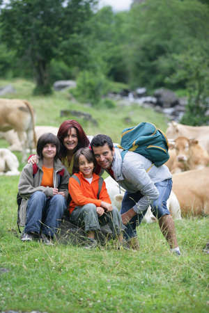 family on a walk in the country photo