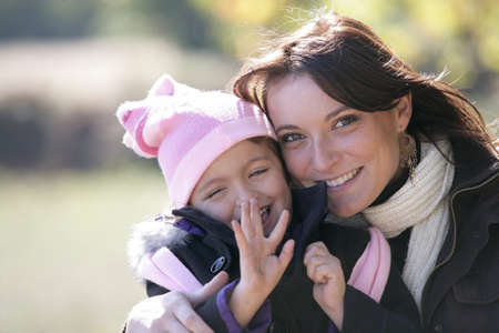 Mother and daughter outside on a sunny winter's day Stock Photo - 13881071