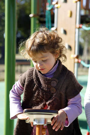 Young girl playing in a playground Stock Photo - 13881910