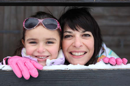 Mother and daughter playing snow photo