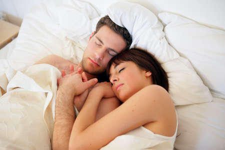 Couple asleep in bed photo