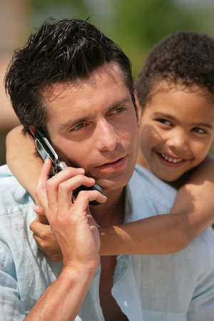 man on phone with little metis boy photo