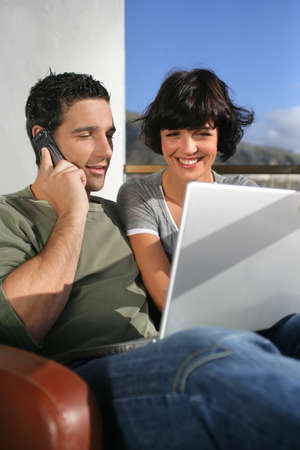 Elated couple learning happy news photo