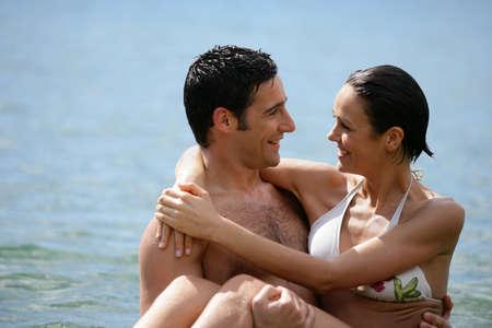 vigorous: Couple embracing in the sea