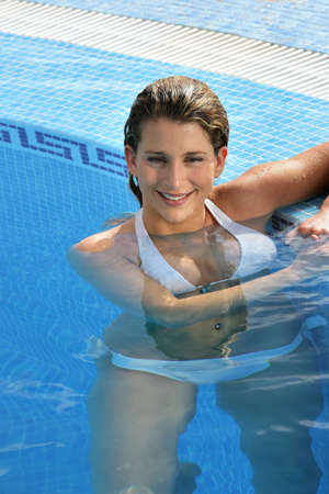 Hot blond woman in the swimming pool photo