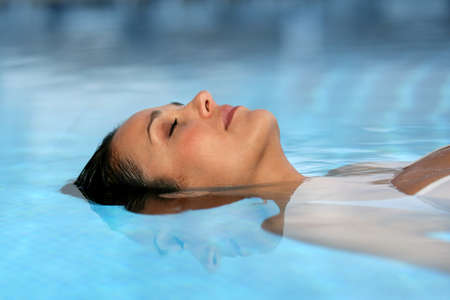 slender: Woman lying in water Stock Photo