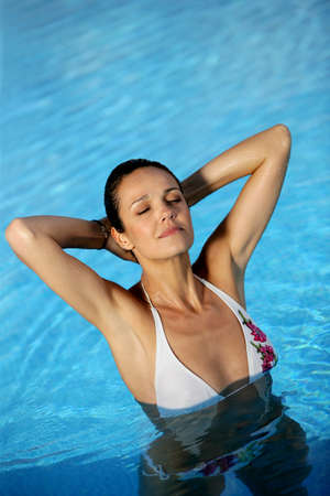 Woman in a swimming-pool Stock Photo - 13884117