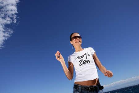 Woman joggin at the beach photo
