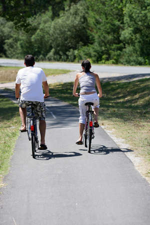 Man and woman having a bike ride photo