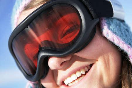 Closeup of a woman wearing a ski mask photo