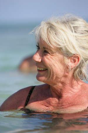 healthfulness: senior woman swimming Stock Photo