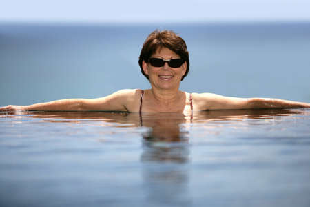 Woman in an infinity pool photo