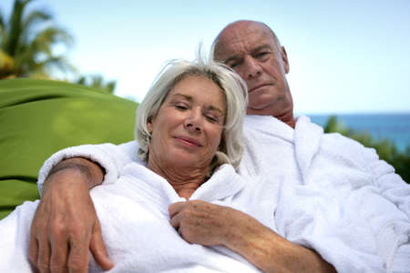 Mature couple enjoying spa weekend at the beach photo