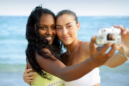 Girls taking a picture while on holiday photo