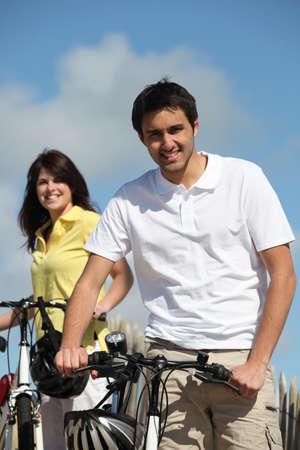 Couple enjoying a bike ride together photo