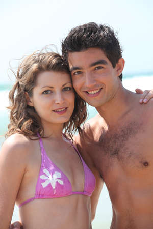 Young couple on the beach Stock Photo - 13884446