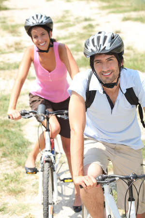 cycling helmet: Couple cycling in the countryside