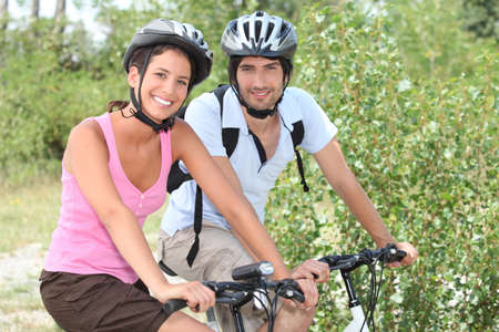 Couple enjoying bike ride photo