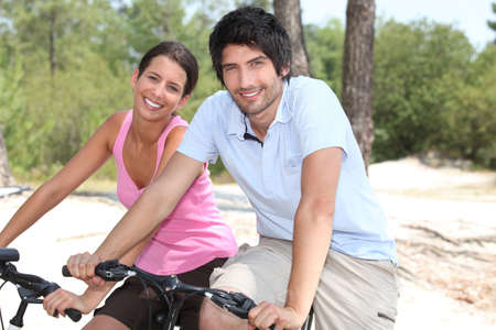 Couple on bicycle photo