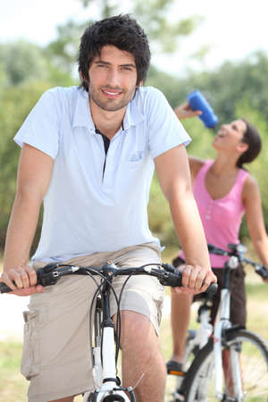 forest management: Couple on bicycle Stock Photo