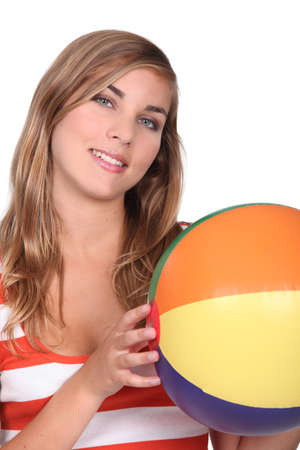Woman holding inflatable beach ball photo
