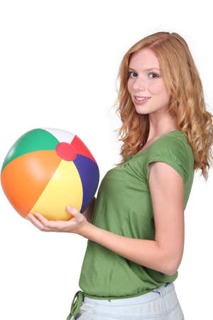 fitted: Teenage girl with beach ball