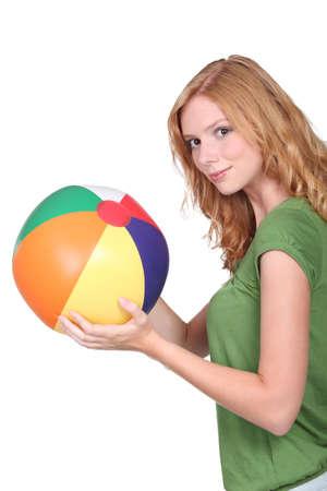 preadult: Teenage girl with beach ball